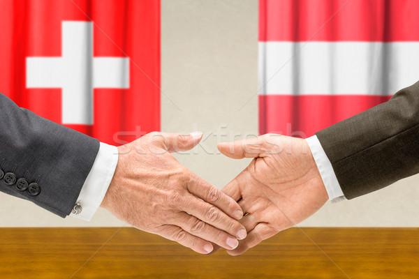Suíça Áustria apertar a mão negócio mãos sucesso Foto stock © Zerbor