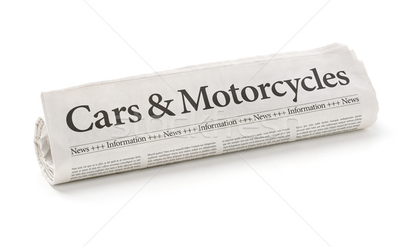 Rolled newspaper with the headline Cars and Motorcycles Stock photo © Zerbor