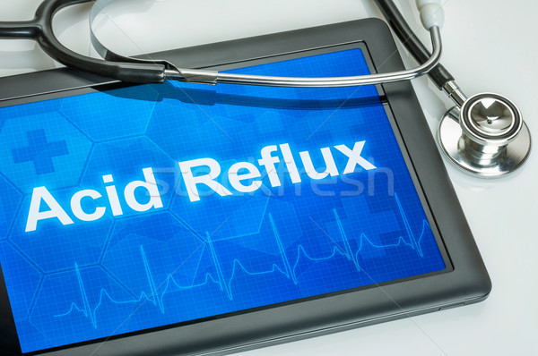Tablet with the diagnosis Acid Reflux on the display Stock photo © Zerbor