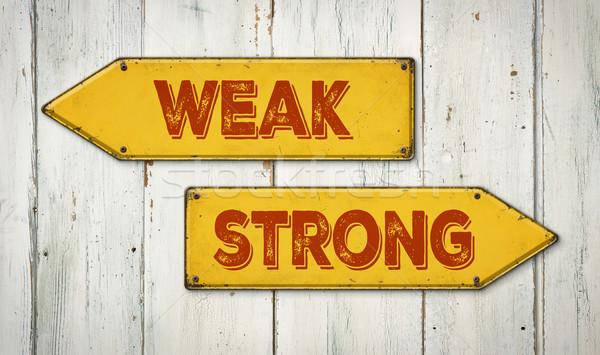Yön işaretleri ahşap duvar zayıf güçlü Stok fotoğraf © Zerbor