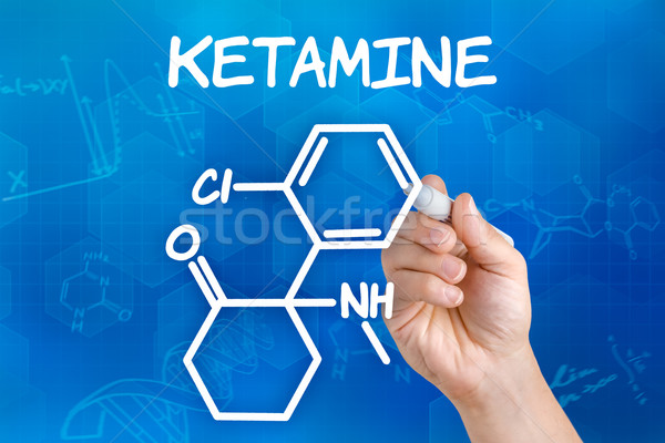 Hand with pen drawing the chemical formula of ketamine Stock photo © Zerbor