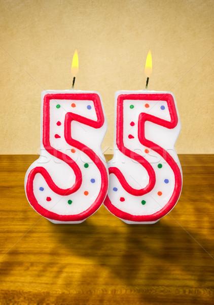Burning birthday candles number 55 Stock photo © Zerbor
