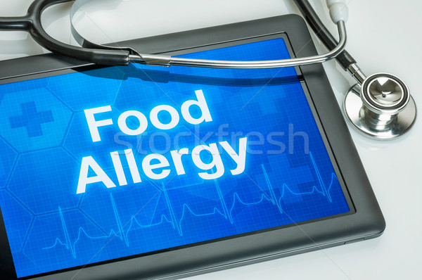 Tablet with the diagnosis food allergy on the display Stock photo © Zerbor
