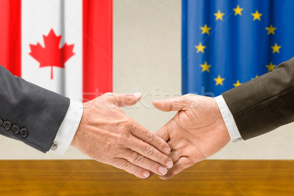 Representatives of Canada and the EU shake hands Stock photo © Zerbor