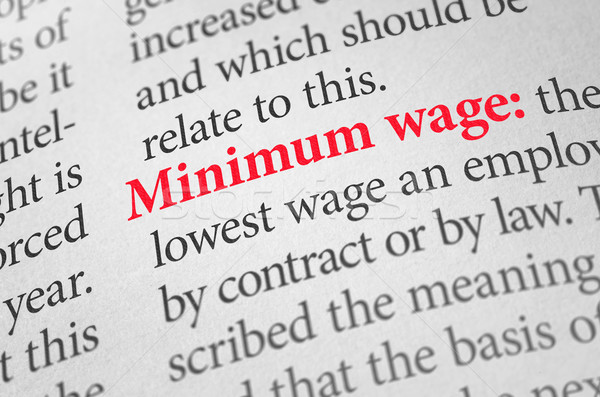 Stock photo: Definition of the word Minimum wage in a dictionary