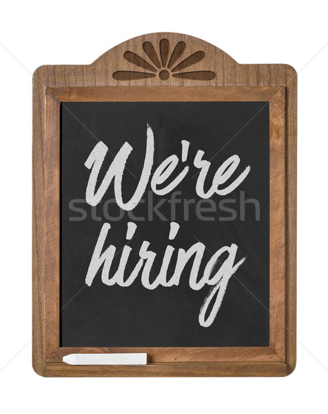 A chalkboard sign on a white background - We are hiring Stock photo © Zerbor