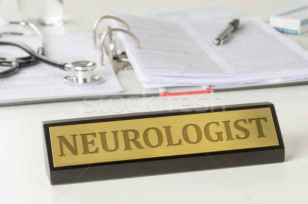 Name plate on a desk with the engraving Neurologist Stock photo © Zerbor