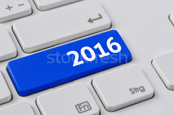 A keyboard with a blue button - 2016 Stock photo © Zerbor