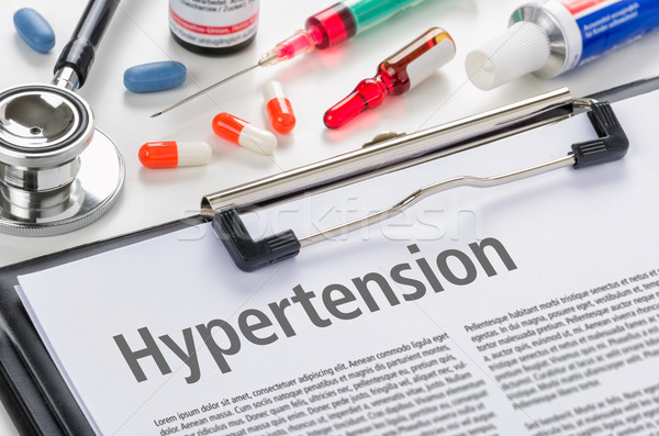 The diagnosis Hypertension written on a clipboard Stock photo © Zerbor