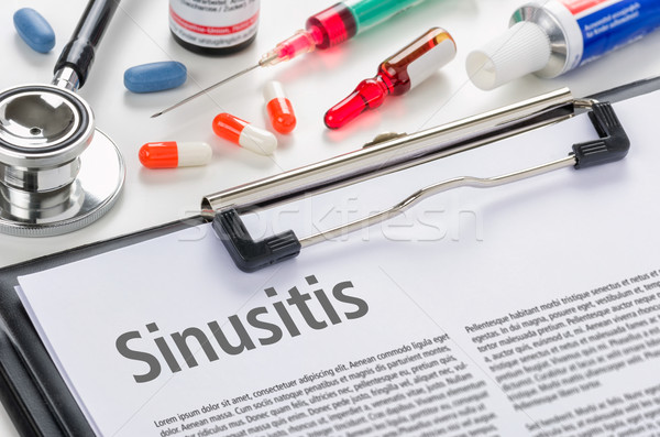 The diagnosis Sinusitis written on a clipboard Stock photo © Zerbor