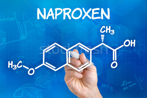 Hand with pen drawing the chemical formula of naproxen Stock photo © Zerbor