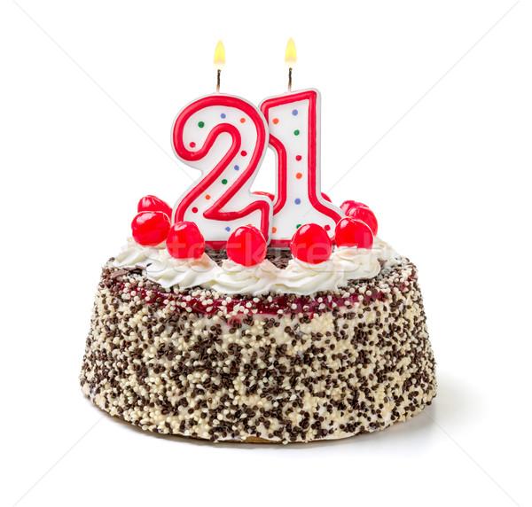 Birthday cake with burning candle number 21 Stock photo © Zerbor
