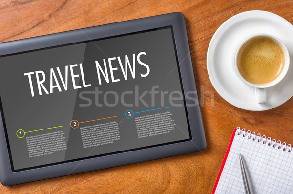 Tablet on a wooden desk - Travel News Stock photo © Zerbor