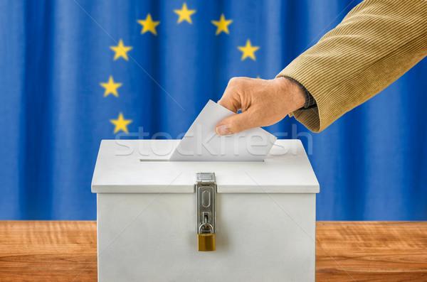 Man putting a ballot into a voting box - European Union Stock photo © Zerbor