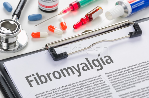 The diagnosis Fibromyalgia written on a clipboard Stock photo © Zerbor