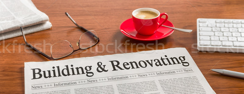 A newspaper on a wooden desk - Building and Renovating Stock photo © Zerbor