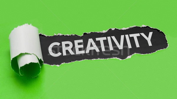 Torn green paper revealing the word Creativity Stock photo © Zerbor