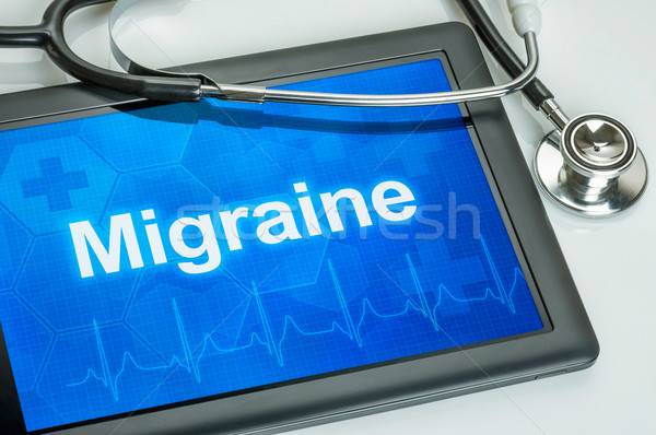 Tablet with the diagnosis migraine on the display Stock photo © Zerbor