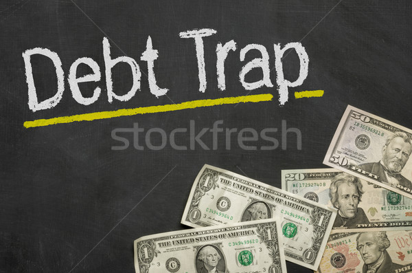 Text on blackboard with money - Debt Trap Stock photo © Zerbor