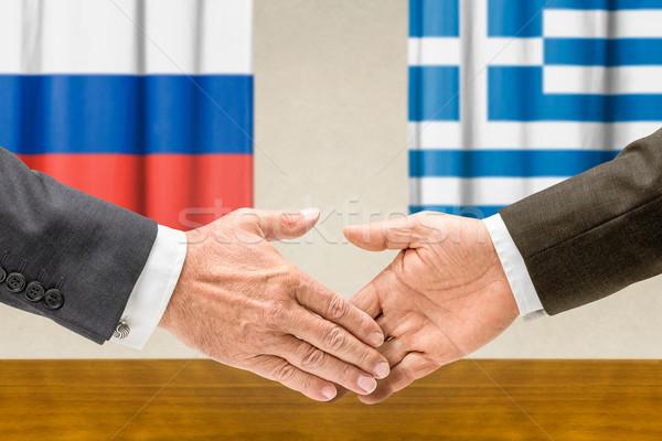 俄國 希臘 握手 業務 手 簽署 商業照片 © Zerbor