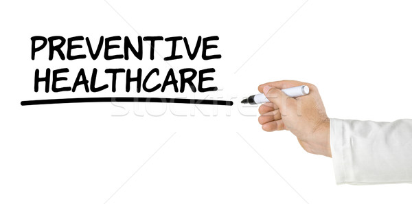 Hand with pen writing Preventive Healthcare Stock photo © Zerbor