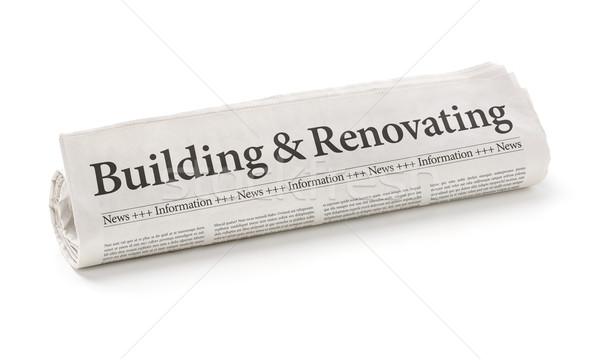Rolled newspaper with the headline Building and Renovating Stock photo © Zerbor