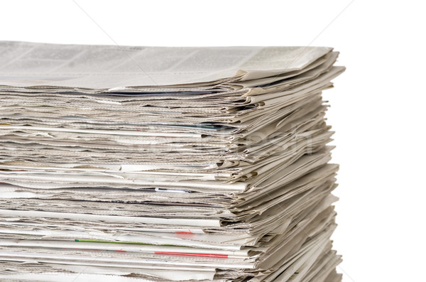 Piled newspapers on a white background Stock photo © Zerbor