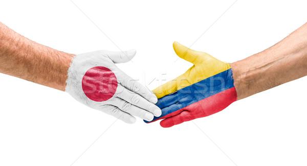 Kézfogás Japán Colombia kéz megbeszélés sport Stock fotó © Zerbor