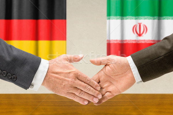 Representatives of Germany and Iran shake hands Stock photo © Zerbor