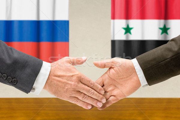 Representatives of Russia and Syria shake hands Stock photo © Zerbor