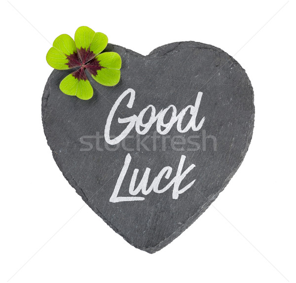 A heart-shaped sign with a four-leafed clover Stock photo © Zerbor