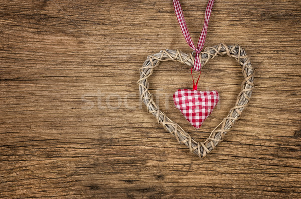 Rustic wooden background with a braided heart Stock photo © Zerbor