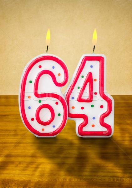 Burning birthday candles number 64 Stock photo © Zerbor