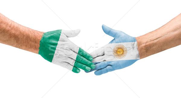Aperto de mão Nigéria Argentina mão reunião esportes Foto stock © Zerbor