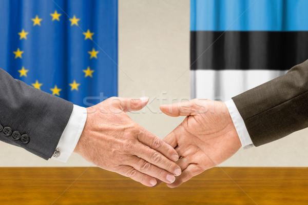 Representatives of the EU and Estonia shake hands Stock photo © Zerbor