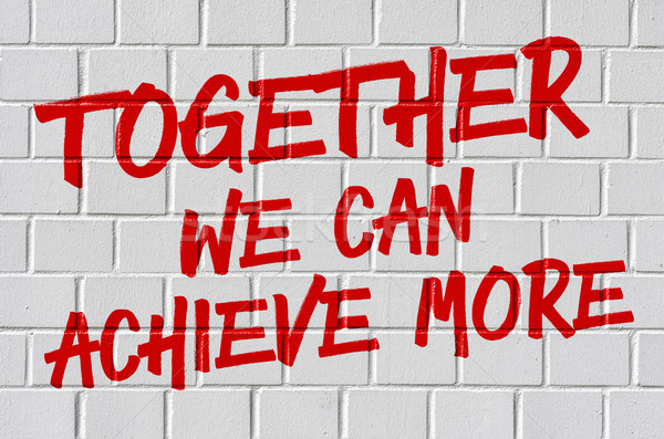 Stock photo: Graffiti on a brick wall - Together we can achieve more