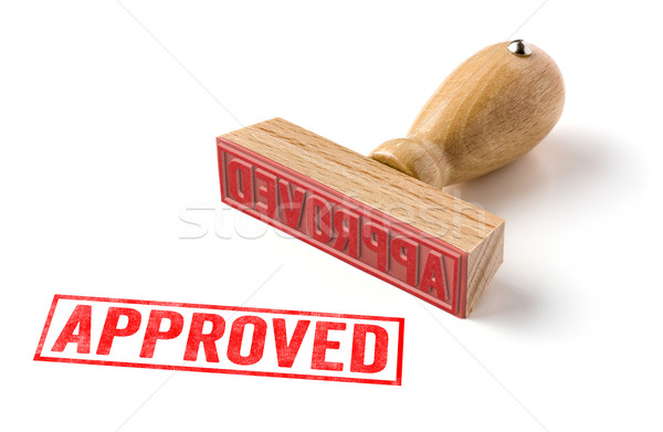 A rubber stamp on a white background - Approved Stock photo © Zerbor