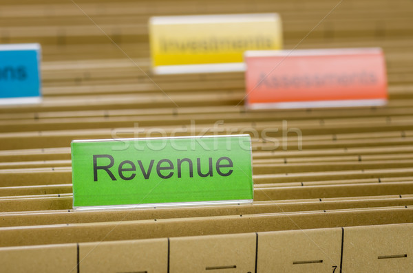 Hanging file folder labeled with Revenue Stock photo © Zerbor