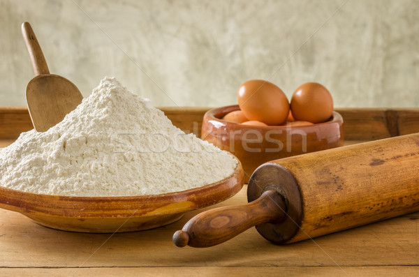 Flour, eggs and old rolling pin Stock photo © Zerbor