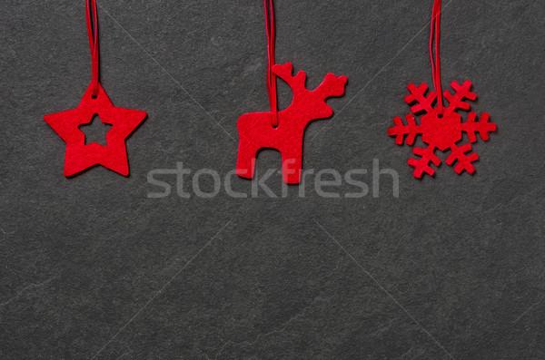 Slate board with three christmassy felt figures Stock photo © Zerbor