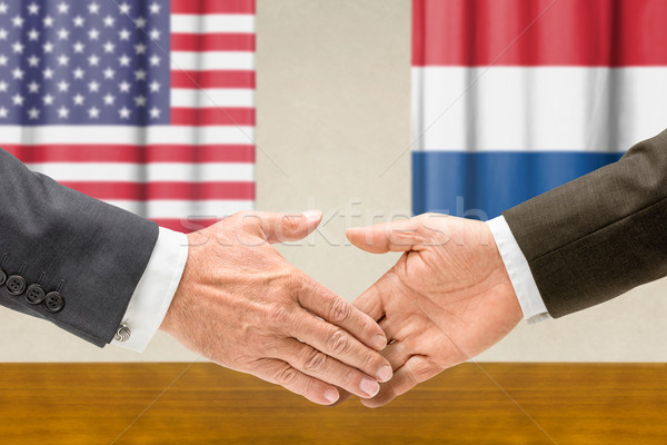 Representatives of the USA and the Netherlands shake hands Stock photo © Zerbor