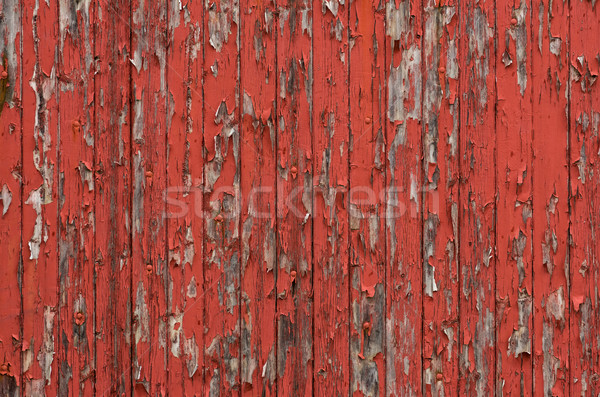 Weathered wooden boards with peeling red paint Stock photo © Zerbor