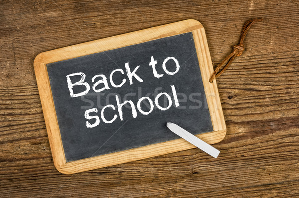 Blackboard with the text Back to school on a wooden table Stock photo © Zerbor