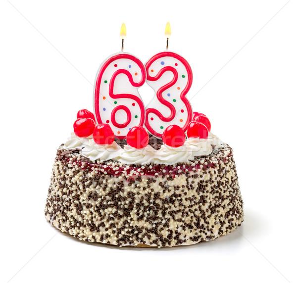 Birthday cake with burning candle number 63 Stock photo © Zerbor