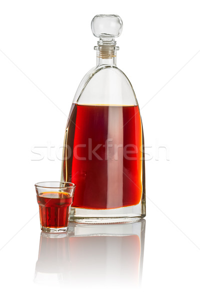 Carafe and beveled shot glass filled with brown liquid Stock photo © Zerbor