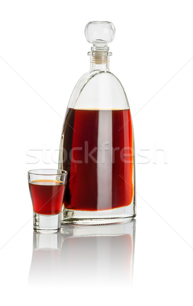 Carafe and shot glass filled with brown liquid Stock photo © Zerbor