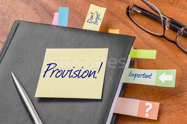 Planner with sticky note - Provision Stock photo © Zerbor