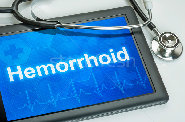 Tablet with the diagnosis Hemorrhoid on the display Stock photo © Zerbor