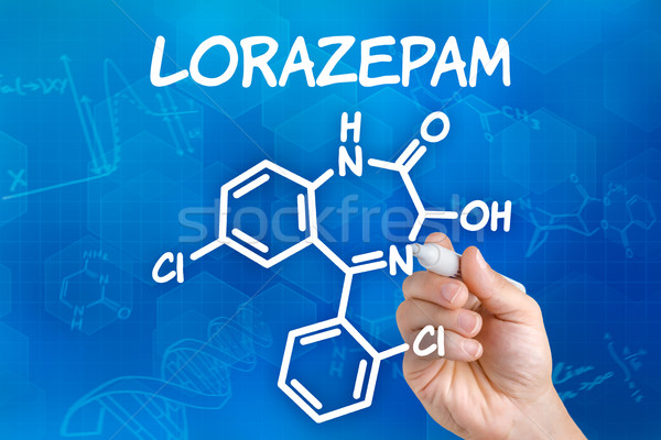 Hand with pen drawing the chemical formula of Lorazepam Stock photo © Zerbor