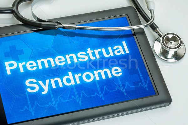 Tablet with the diagnosis Premenstrual Syndrome on the display Stock photo © Zerbor